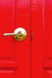 Red wooden door - the door handles. Royalty Free Stock Images