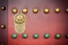 Red wooden door with golden lion figure at the Forbidden City, Beijing Stock Photos