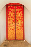 Red wooden door with golden thai  pattern Royalty Free Stock Image