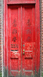 Red Wooden Door in a Red Brick Building in Chinatown Royalty Free Stock Image