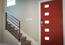 Red Wooden Door Beside Stairs Stock Photos