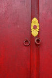 Red wooden door with texture at Khmer temple Royalty Free Stock Photo