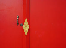 Red wooden door with texture at Khmer temple Royalty Free Stock Photos