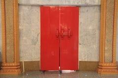 Red Wooden door in Thai temple Stock Photo