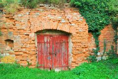 Red wooden door to an old wine cellar Royalty Free Stock Photo