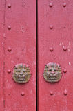 Red wooden door in traditional style. Red wooden door with decoration beast head in Chinese traditional style, shown as feature and detail of architecture, color Royalty Free Stock Photography