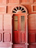 Red wooden door and wall at Mandalay Palace. In Myanmar royalty free stock photos