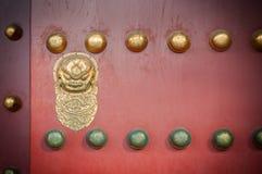 Red Wooden Door With Golden Lion Figure At The Forbidden City, Beijing Stock Photos