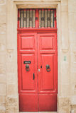 Red Wooden Doors with Black Lion Shaped Knockers in Mdina, Malta Royalty Free Stock Images