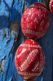 Red wooden easter eggs over blue tree bark Stock Photography