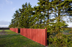 Red wooden fence stock photo