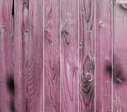 Red wooden fence, close up, texture, background. Natural wood. Vertical bars.  Royalty Free Stock Images