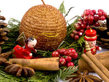 Red wooden figure, candle and thuja branc Stock Photos