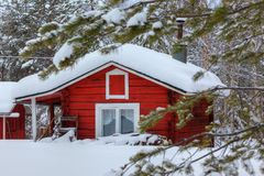 Red wooden finnish house in the forest. Stock Image