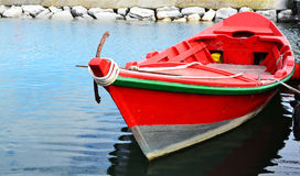 Red Wooden Fishing Boat Floating Stock Photo
