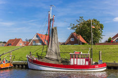 Red wooden fishing boat in the harbor of Greetsiel Royalty Free Stock Images