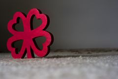 Red wooden four leaf clover Royalty Free Stock Images