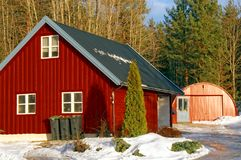 Red wooden garage in winter Royalty Free Stock Photo