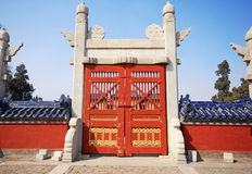 Red wooden gate in Temple of Heaven, Beijing, China. Stock Photos