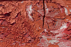 Red wooden with grunge paint. Textured surface stock images
