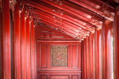 Red wooden hall in Citadel of Hue, Vietnam, Asia. Red wooden hall in Citadel in Vietnam, Asia. Beautiful design inside Hue Imperial City. Traditional asian royalty free stock photo