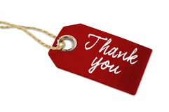 Red wooden hang tag with thank you stock image