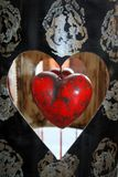 Red Wooden Heart in Black and Gold Metal Frame stock images