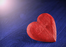 Red wooden heart on blue background Stock Photos