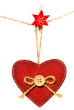 Red wooden heart with button hanging on a rope, isolated on white background Royalty Free Stock Photos