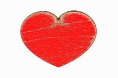 Red wooden heart closeup, object is isolated on white background.The heart-symbol and sign of Valentine`s Day Royalty Free Stock Image