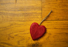 Red Wooden heart on floor boards Royalty Free Stock Images