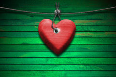 Red Wooden Heart on Green Wood Background Royalty Free Stock Images