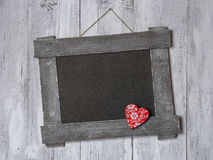 Red wooden heart on an old empty board Stock Image