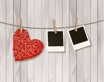 Red wooden heart with photographs. Stock Photos
