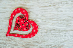 Red wooden heart placed on a white wood board royalty free stock photography