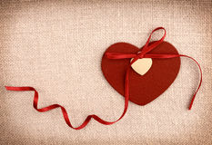 A red wooden heart with a ribon bow Royalty Free Stock Photography