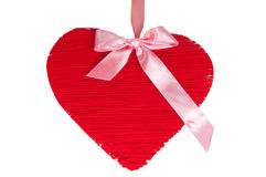 Red wooden heart with silk pink bow isolated Royalty Free Stock Images