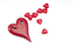 Red wooden heart and smaller chocs Stock Images
