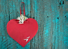 Red wooden heart on turquoise rustic wood Stock Image