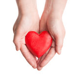 Red wooden heart in woman's hands Royalty Free Stock Image
