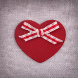 A red wooden hearth with a fabric bow Royalty Free Stock Image