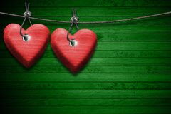 Red Wooden Hearts on Green Wood Background Royalty Free Stock Photos