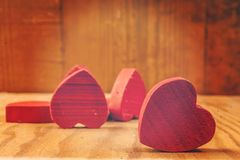 Red wooden hearts in the background. Red wooden hearts on wooden table in the background Royalty Free Stock Image