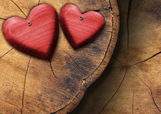Red Wooden Hearts on Trunk Section Royalty Free Stock Photos
