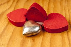 Red wooden hearts with lights in the background. Red wooden hearts on wooden table in the background Stock Images