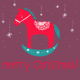 Red wooden horse merry Christmas greetings card Royalty Free Stock Photography