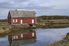 Red wooden house on the Atlantic Road Royalty Free Stock Image