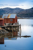 Red wooden house on the coast in Norway Royalty Free Stock Photos