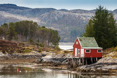 Red wooden house on the coast in Norway Stock Photography