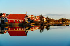 Red wooden house on the fjord Royalty Free Stock Photo